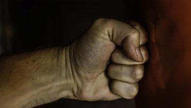 Fist hitting a punching bag